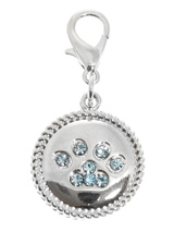 Swarovski Paw Dog Collar Charm (Blue Crystals) - A charm to remind you who really is the Boss, it's the little guy with the four legs! The paw is make up of 8 blue Swarovski Crystals set in a silver alloy fob with roped edging. Attaches to any collar's D-ring with a lobster clip. Measures approx. 1'' / 2.5cm wide.