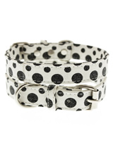 Black / White Polka Dot Glitter Collar - This striking black and white leather collar with stitched edging has a hint of glitter and will look great for walkies. A very smart addition to the wardrobe of any trendy pooch.S-M Width: 14mmM-L Width: 19mmL-XL Width: 25mm