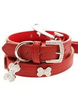 Red Leather Diamante Collar / Diamante Bone Charm & Lead Set - Sparkling Bling Collar and Lead Set. This textured red leather collar with a stitched edging has a crystal encrusted buckle with three large / bling sparkling diamante bones and a large sparkling diamante charm complete the look. A glamorous addition to the wardrobe of any trendy pooch. Matching lea...
