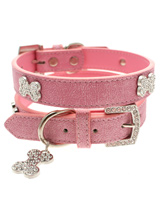 Pink Leather Diamante Collar & Diamante Bone Charm - Sparkling Bling Collar! This textured pink leather collar with a stitched edging has a crystal encrusted buckle with three large / bling sparkling diamante bones and a large sparkling diamante charm complete the look. A glamorous addition to the wardrobe of any trendy pooch.S-M Width: 14mmM-L Width:...