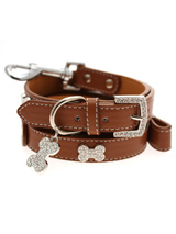 Brown Leather Diamante Collar / Diamante Bone Charm & Lead Set - Sparkling Bling Collar & Lead Set. This brown leather collar with a stitched edging has a crystal encrusted buckle with three large / bling sparkling diamante bones and a large sparkling diamante charm complete the look. A glamorous addition to the wardrobe of any trendy pooch. Matching lead has sil...